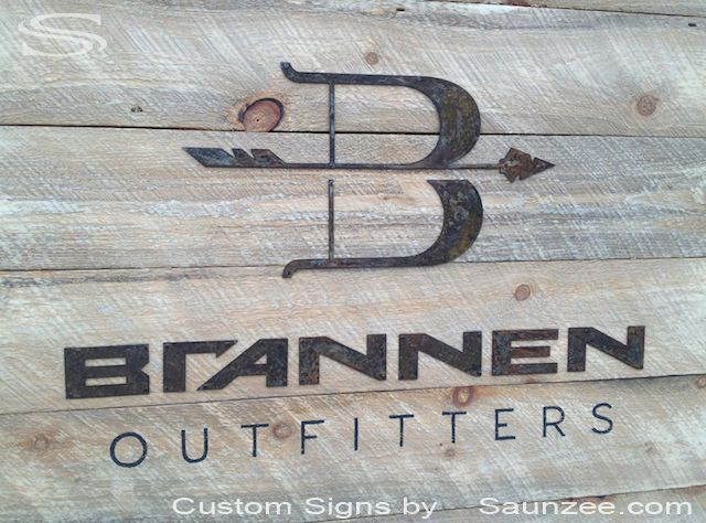 saunzee custom commercial sign makers rustic old wood rusty metal letters nailed to weathered barn wood sign stained black metal sign brannen outfitters