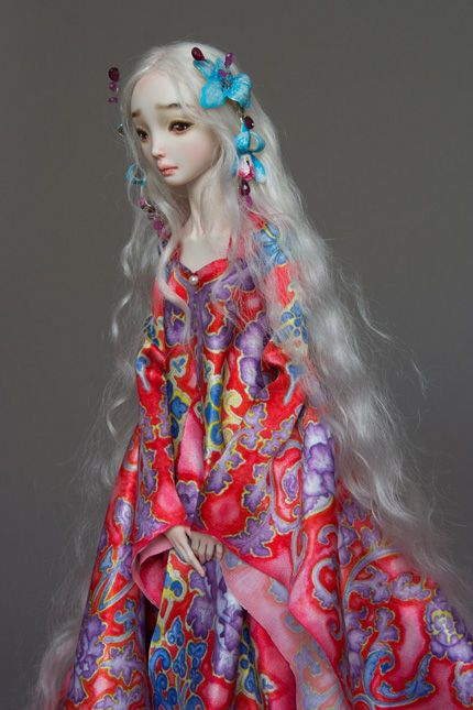 There is a sadness in this doll's demeanor. I like her hair and dress and sad eyes~like she she has been crying...