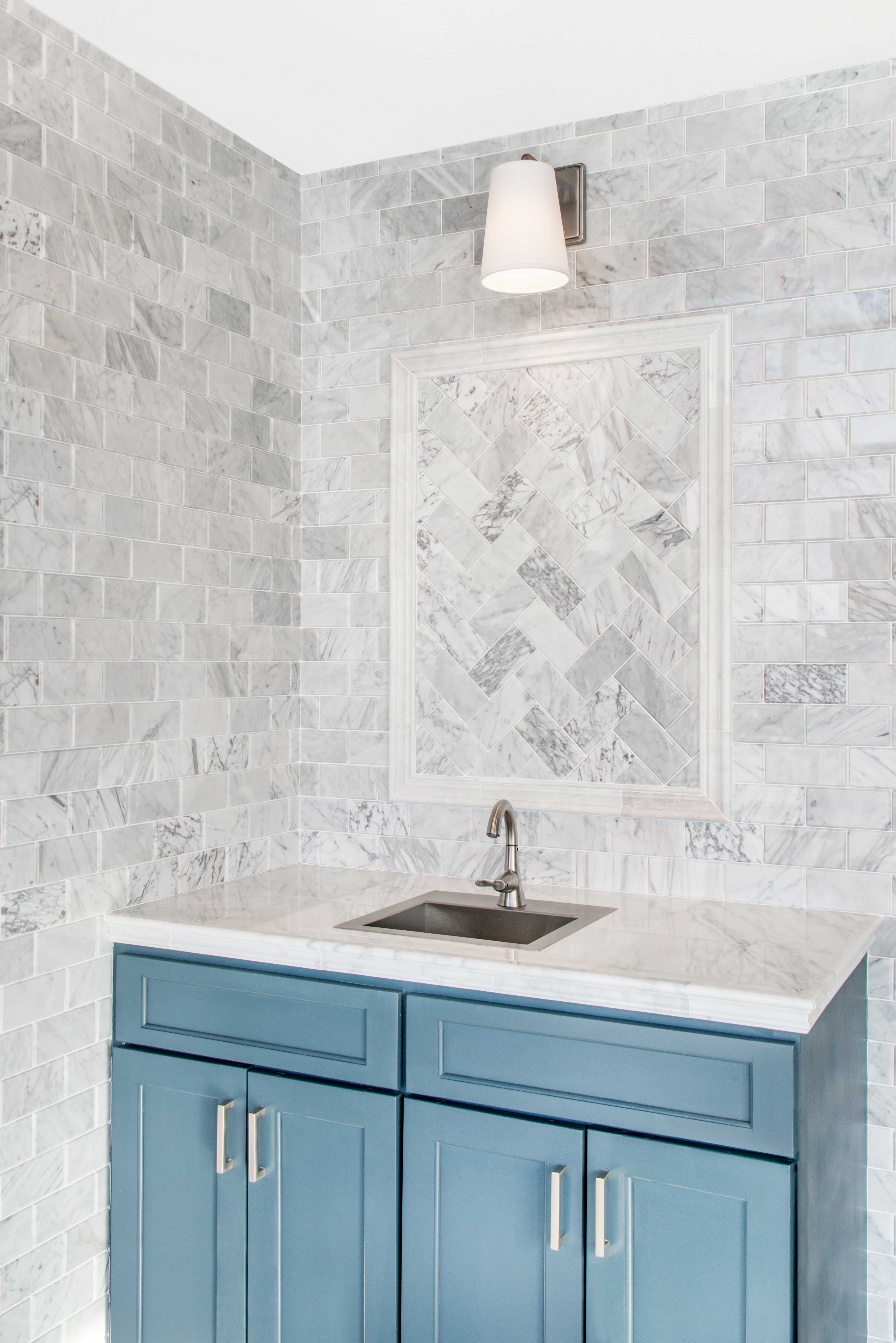 Infused with dramatic grey veining, this beveled subway tile adds ...