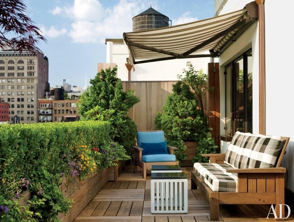 14 Cozy Balcony Ideas And Decor Inspiration Architectural Digest Patio Deck Designs Patio Small Patio