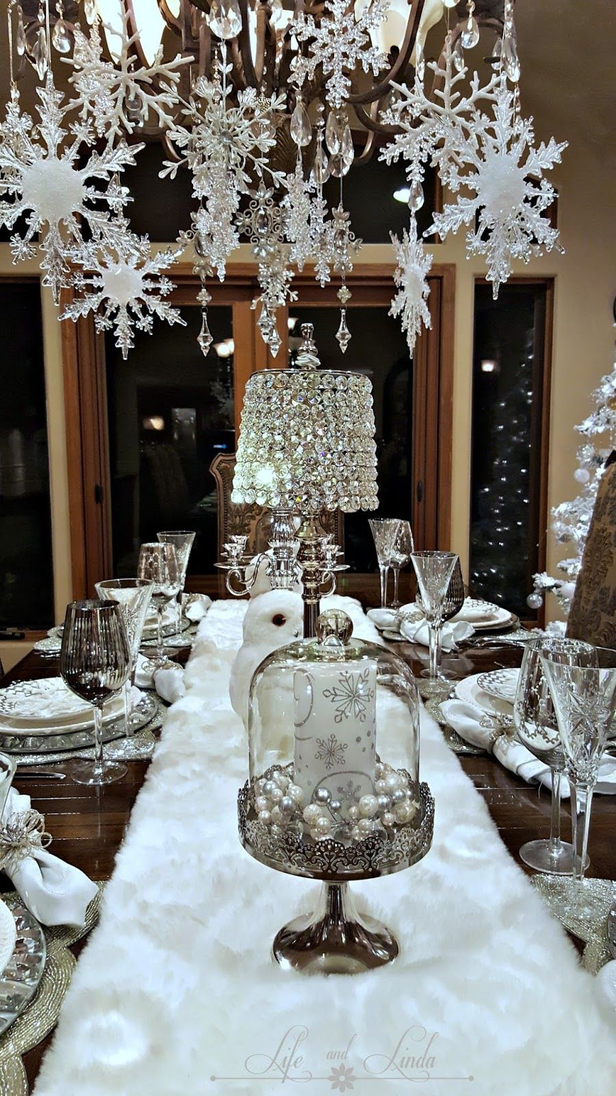 a lovely holiday tablescape with snowflakes silver and white