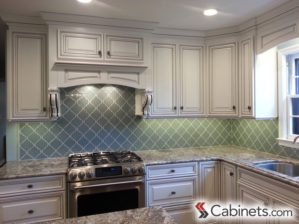 Bright White Cabinets Paired With Aqua Backsplash And Stainless Steel  Appliances Cabinets: Deerfield Bronson Maple