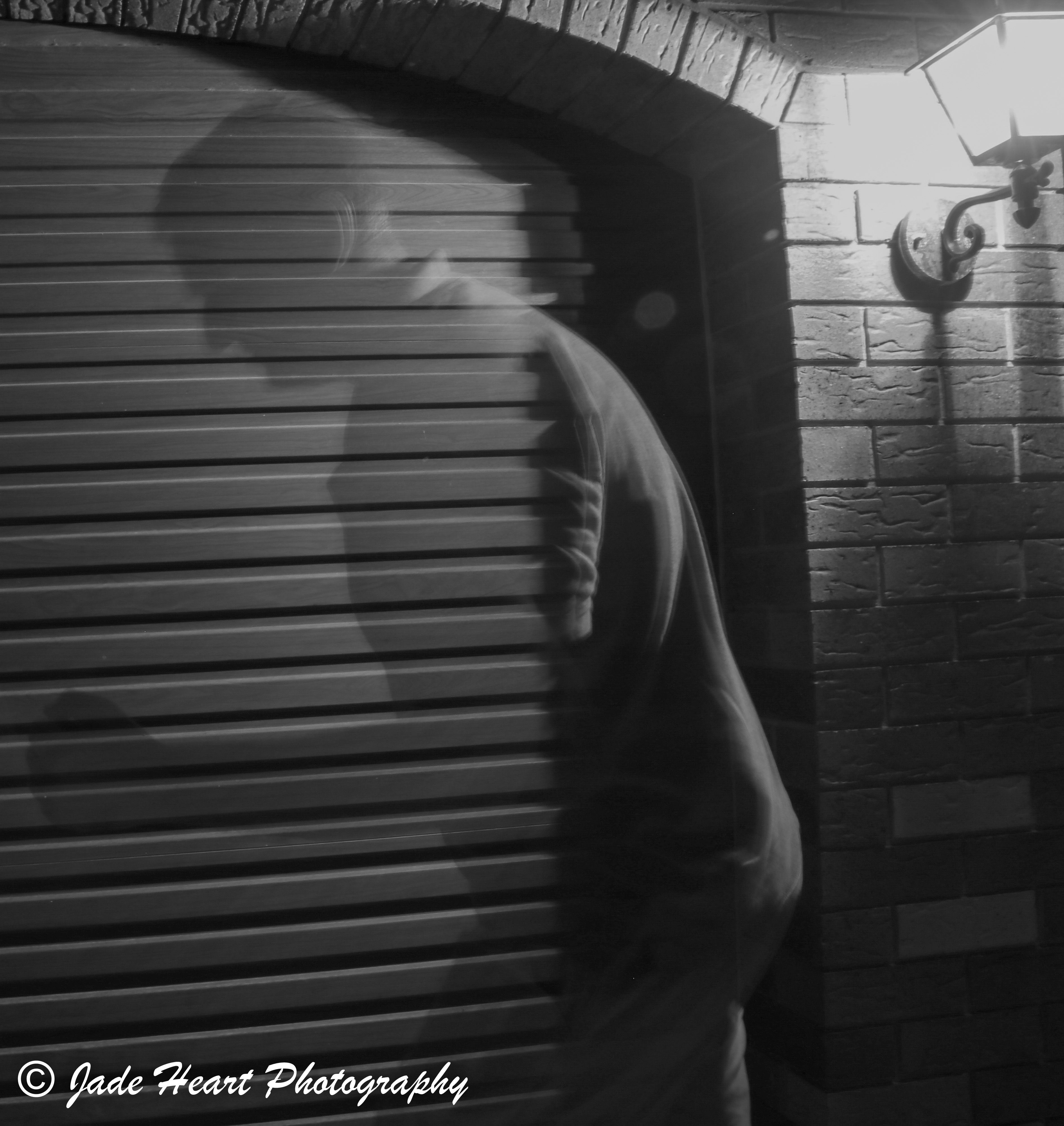 L4M2AS3 -Part A: Night Lights: Ghost Photography - M Mode - Canon EOS 80D - Shutter Speed  10.7 sec - ISO 100 - Aperture f/10 - Exposure Bias 0 step - Focal length 16mm - Handheld - Playing with shadow and light outdoors to create a shadow ghost effect of the subject. This series is kept in black and white to remove the distraction of colours and focus on the ghost effect.