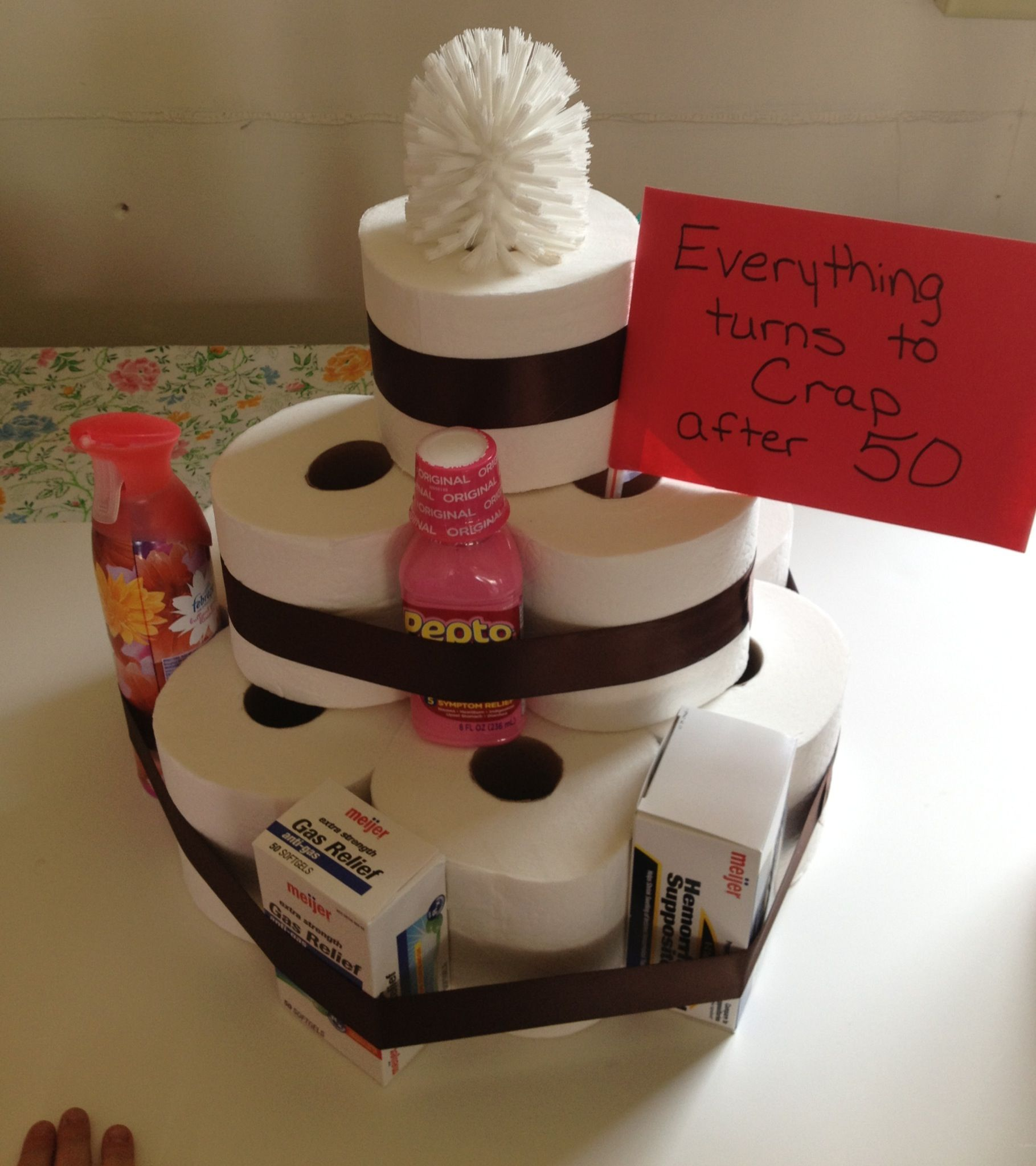 Toilet paper cake fun gag gift for anyone turning 50 for 50th birthday party decoration ideas diy