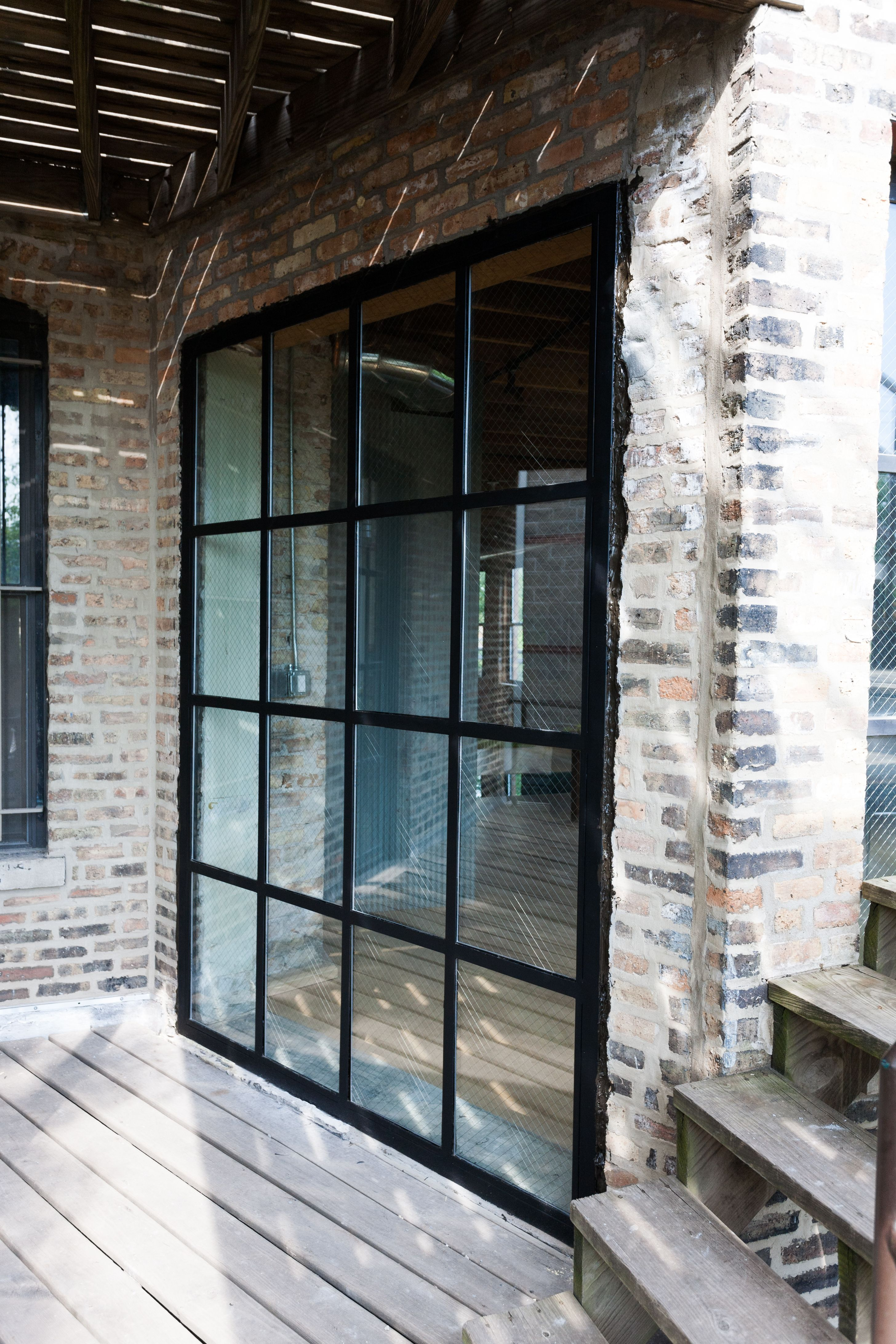 Steel And Glass Wall Makes For A Big Window Home Renovation Steel And Glass Wall Iron Door Steel And Glass Room Divide Glass Wall Iron Doors Modern Windows