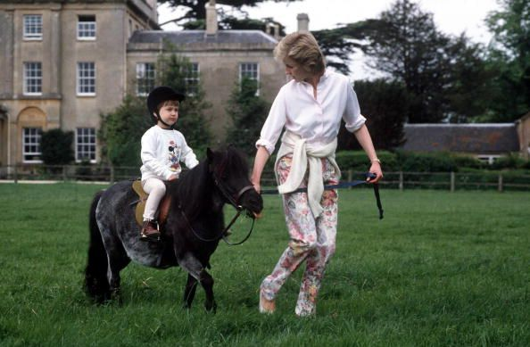 At Highgrove House (the family home of Prince Charles), Prince William spends a summer afternoon riding his pony with a little bit of help from his mother in 1986.    - HouseBeautiful.com