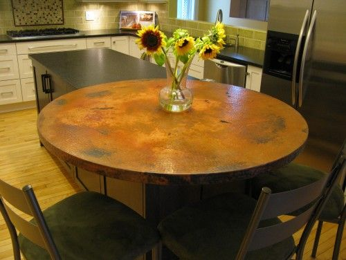 A copper topped table, the more you touch it the nicer it looks.