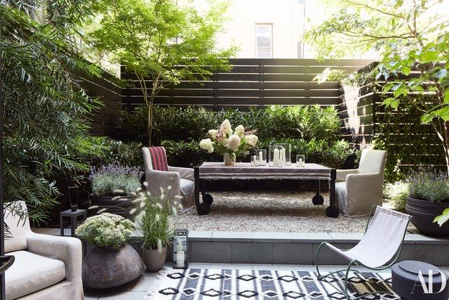 The garden. small, lush, nyc, private, outdoor furniture, outdoor rug, fence - Step Inside Monique Gibson's NYC Townhouse Patios, Gardens