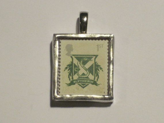 UK 1st class Slytherin stamp encased in glass pendant. This stamp is part of the 2007 Harry Potter set.