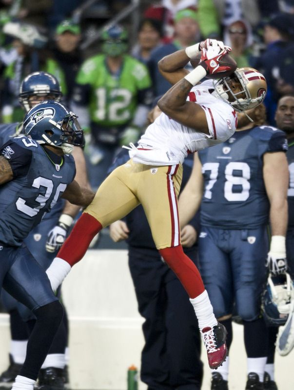 2011-12-24  SEATTLE, WA - DECEMBER 12: Wide receiver Michael Crabtree #15 of the San Francisco 49ers pulls in a 41 yard pass while covered by Brandon Browner #39 of the Seattle Seahawks. Final score 19-17, 49ers.