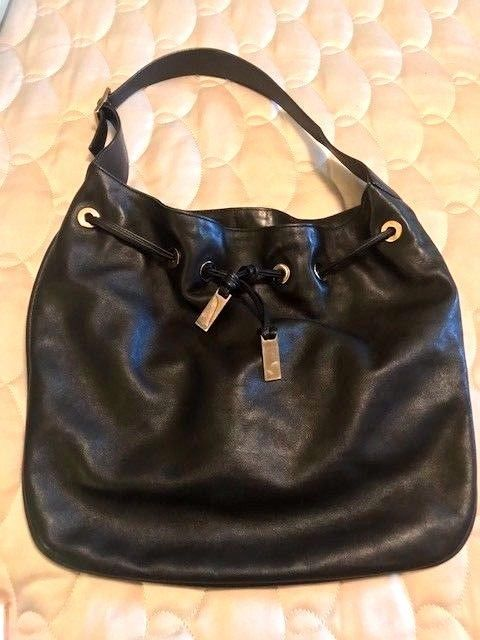 4c1f2a1add3 Authentic Vintage Gucci Black Leather Hobo Drawstring Handbag  Gucci  Hobo