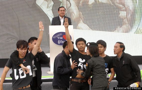 """Following months of protests in Thailand by rival political movements, the country's military seized power in a bloodless coup this May. Thailand's ruling junta has banned protests and other expressions of opposition -- including a three-fingered salute borrowed from the """"The Hunger Games"""" books and movies."""