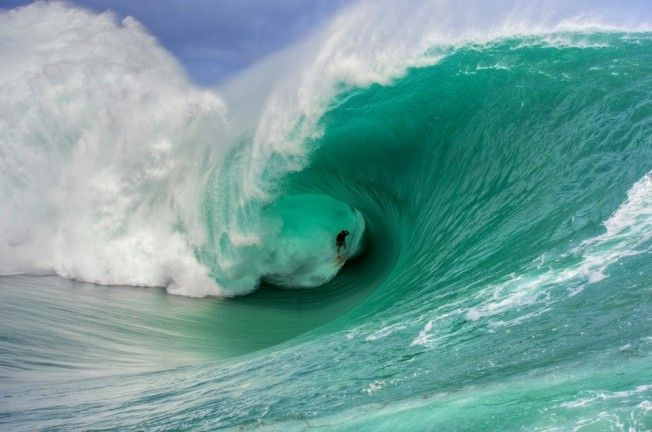 nathan fletcher - teahupoo - photo tim mckenna
