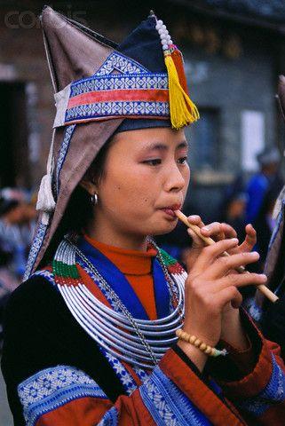 China | Hmong Flutist Wearing Traditional Dress.  Guizhou Province | © Liu Liqun/Corbis