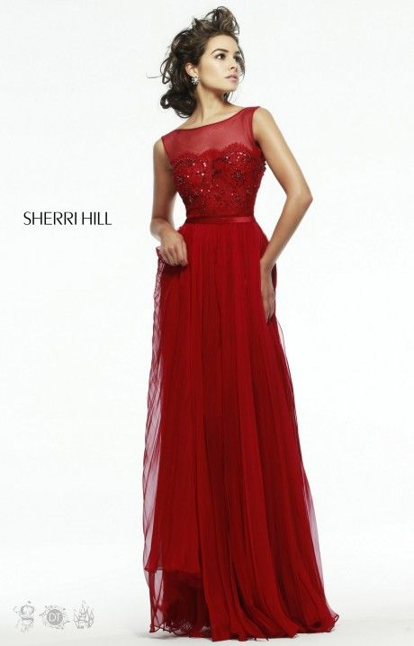 Sherri Hill 4804 is a lovely gown for your special night! We love the illusion neckline atop a detailed bust. The silhouette of this gown is an empire waist gown with a flowy chiffon skirt. Be classy in Sherri Hill 4804!