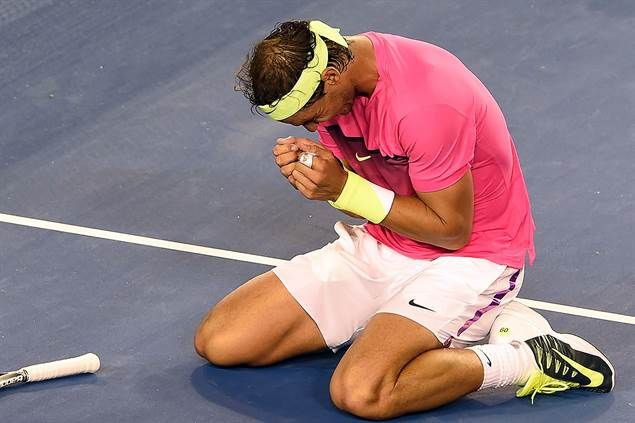 Australian Open, 21.01.2015 Rafael Nadal fell to his knees following his 6-2, 3-6, 6-7(2), 6-3, 7-5 victory over Tim Smyczek Wednesday.