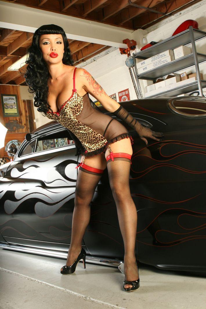 Tattooed car sales girl in asian showroom - 3 5