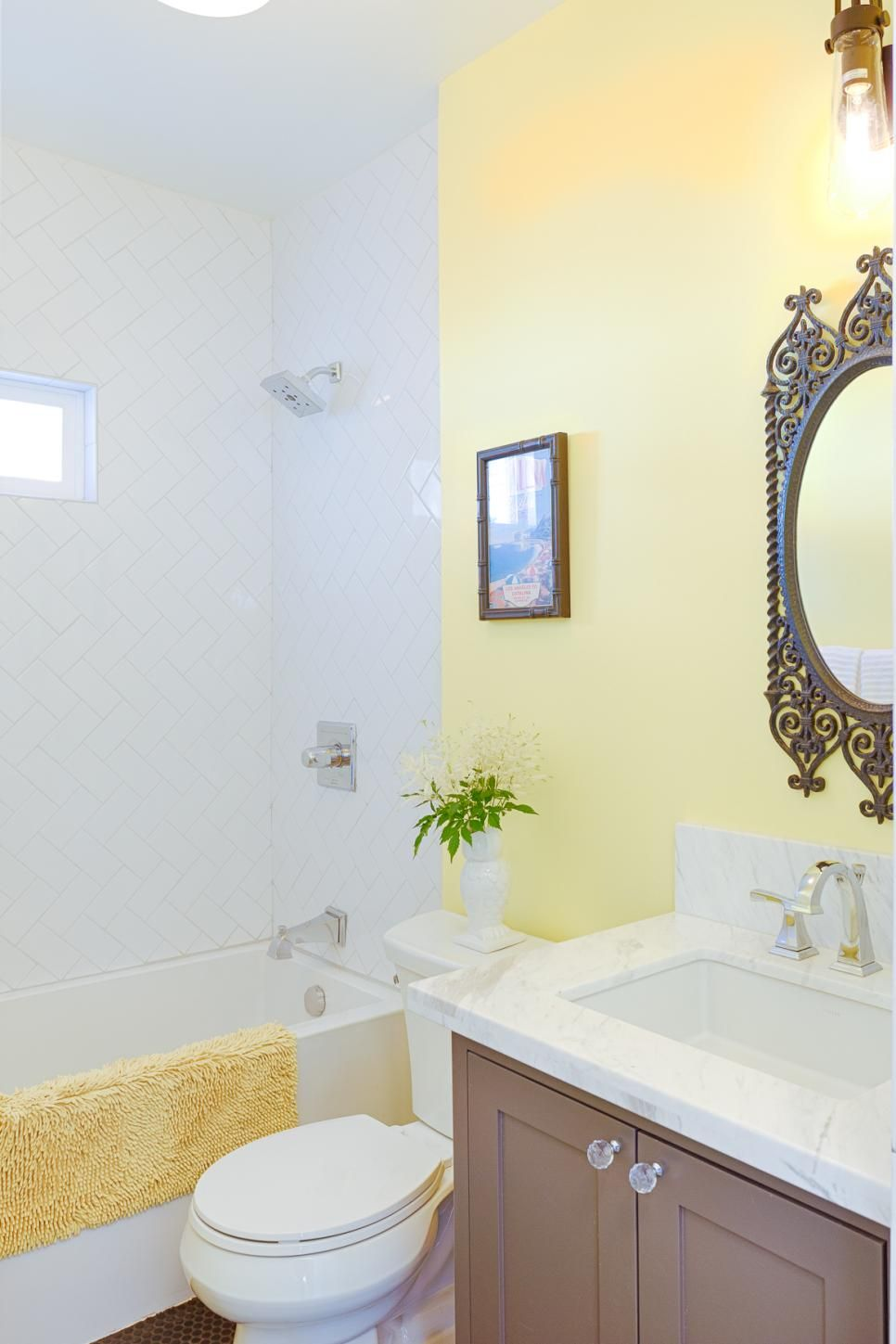 A coffee colored vanity and mosaic tile floor are an imaginative ...