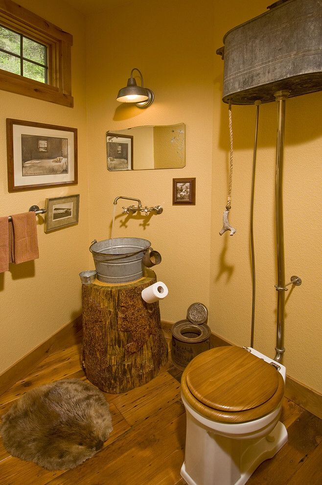 Rustic High Tank Toilet with Galvanized Bucket Sink