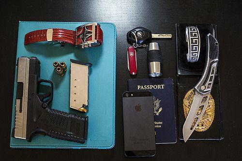 iPad in Brookstone iPad case Springfield Armory XDs with...