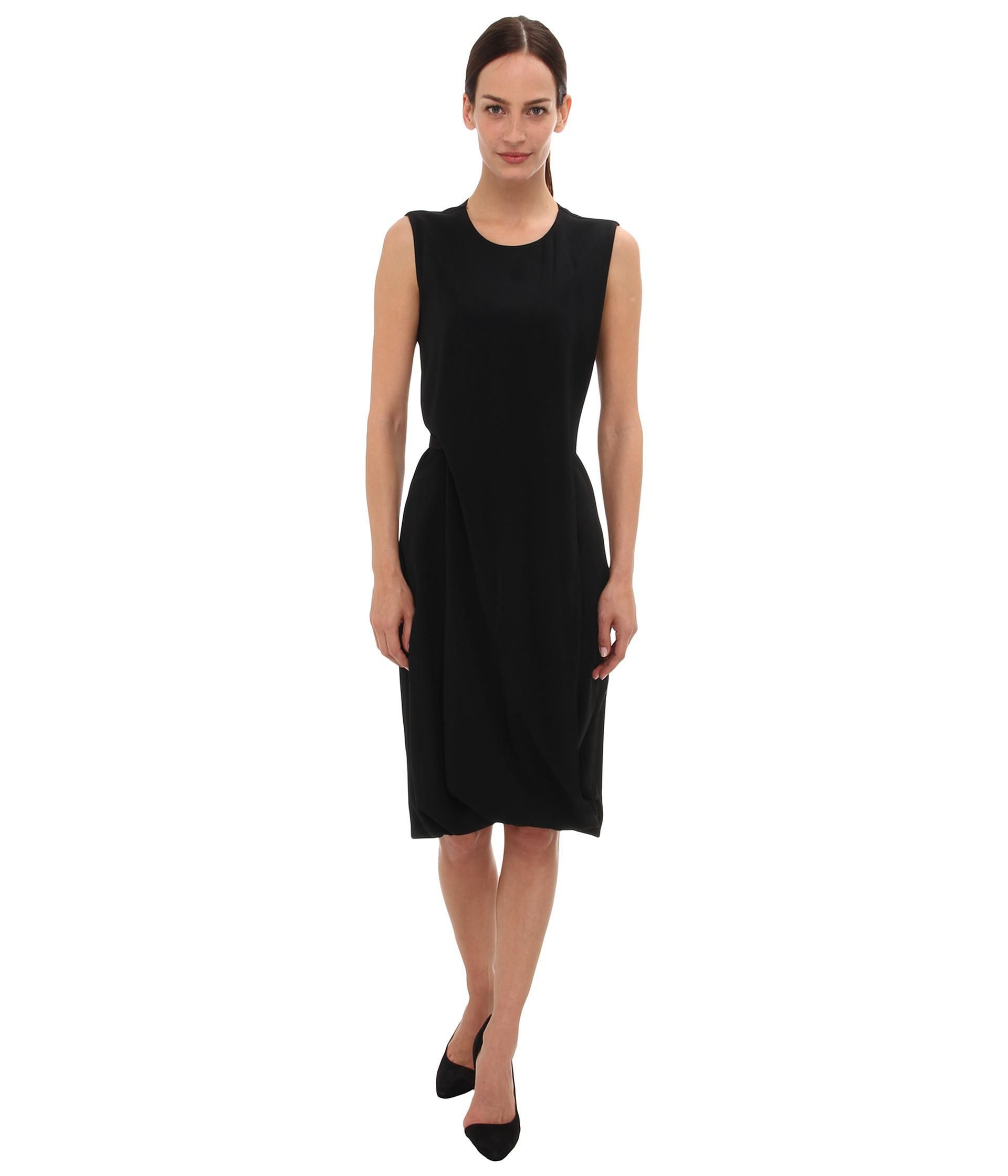 Easily transition from office to evening in this flawless Calvin Klein Collection™ Sheath Dress. ...