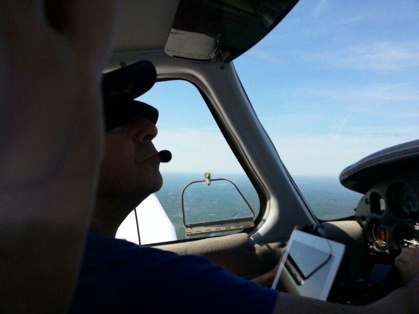 I was acting as safety pilot for a friend doing IFR currency practice.  Notice the special goggles that restrict visibility outside of the cockpit.