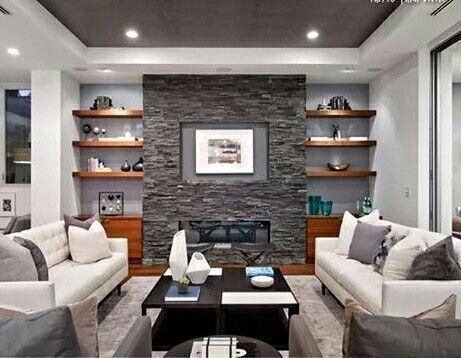 Pared con piedras grises como punto principal de la sala for Decoracion de casas con piedras