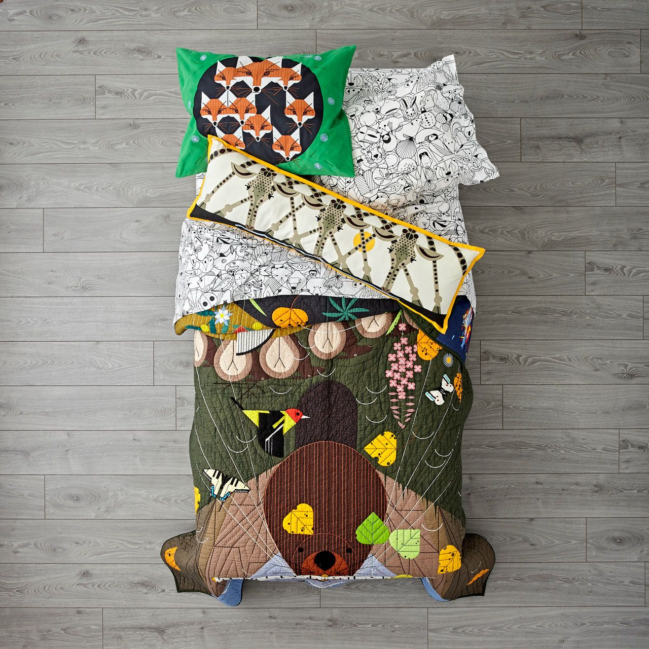 The Land of Nod launches new bedding, pillows, rugs, storage, lighting, shower curtains, and more, featuring Charley Harper's nature-inspired illustrations.