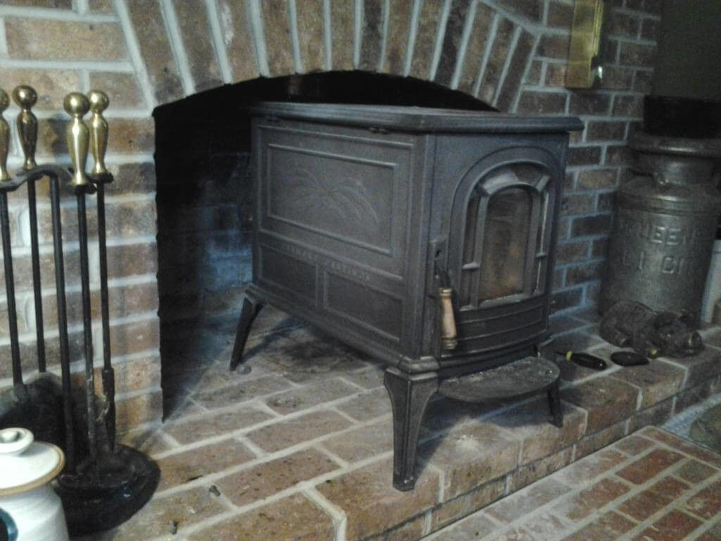 Vintage Regency Wood Stove And Cast Iron Wood Burning Stoves With Rustic Fireplace Mantle For Rustic Home Interior Wood Stove Rustic Fireplace Mantle Fireplace