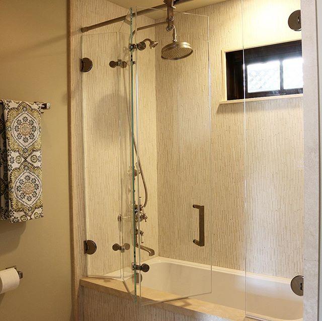 Bi-folding shower door Glass doors that open the bath right up