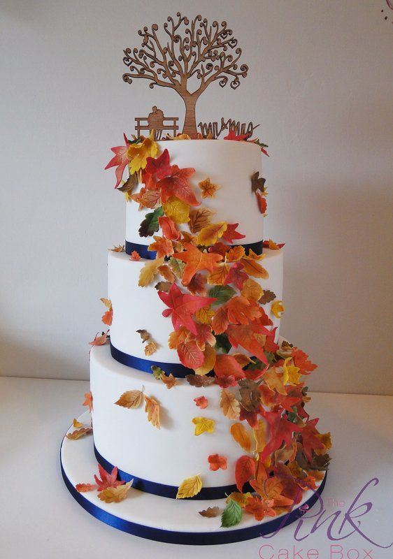 Autumn Leaves Wedding Cake With Wooden Topper And Navy Ribbons