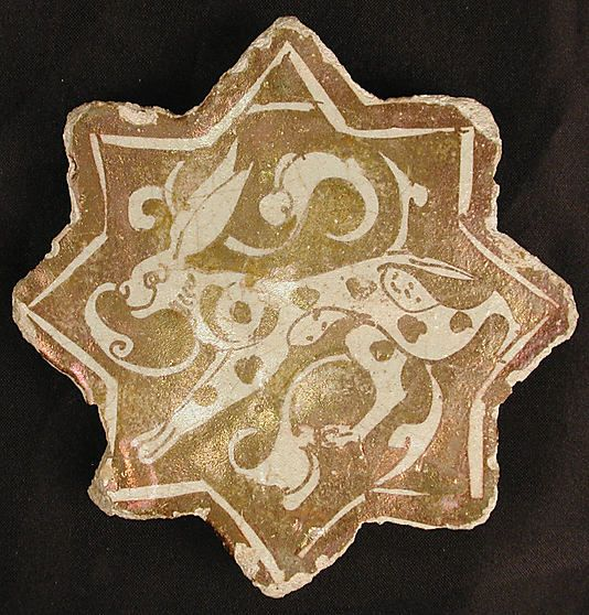 Star-Shaped Tile Object Name: Star-shaped tile Date: first half 13th century Geography: Iran Culture: Islamic Medium: Stonepaste; overglaze luster-painted Dimensions: W. 5 1/2 in. (14 cm) Classification: Ceramics-Tiles Credit Line: The Grinnell Collection, Bequest of William Milne Grinnell, 1920 Accession Number: 20.120.72