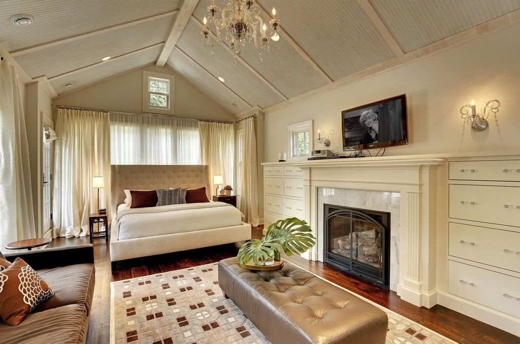75 Impressive Master Bedrooms with Fireplaces | Tufted bench ...