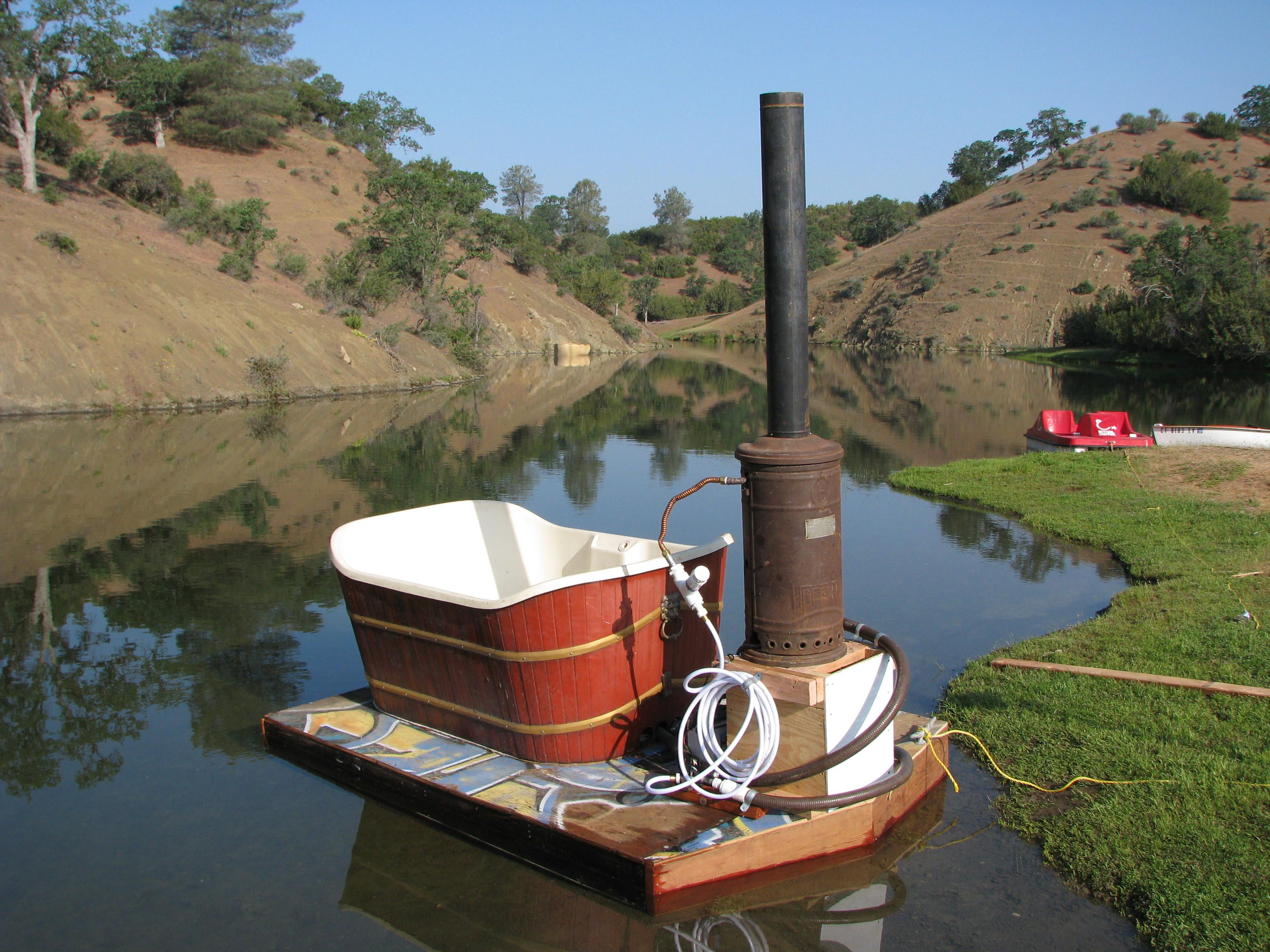 Floating Tub With On Board Wood Burning Water Heater