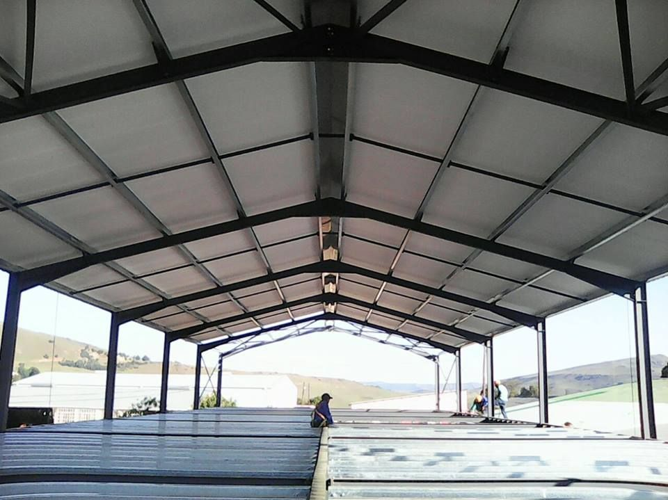 The Team From Rig Tech Steel Structures Installing Isoboard Over Purlin At Spar Underberg Another Happy Customer Steel Structure Installation Structures