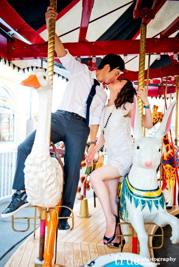 Carousel Engagement Photo Shoot Belmont Park in Mission Beach. Whimsical engagement shoot on a merry-go-round with a carnival atmosphere!