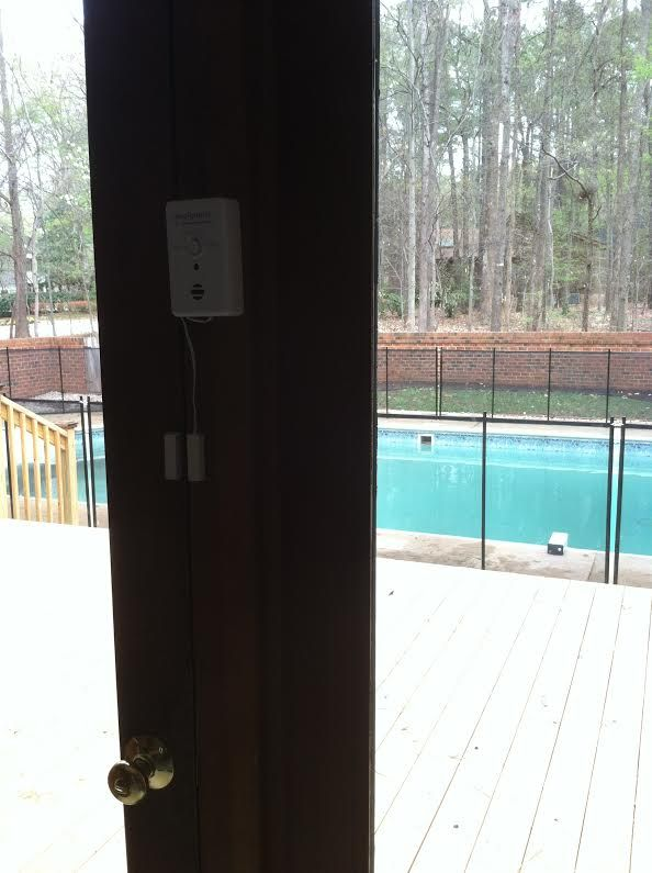 3 layers of protection in 1 photo. 1 door alarm, 1 pool fence and 1 ...
