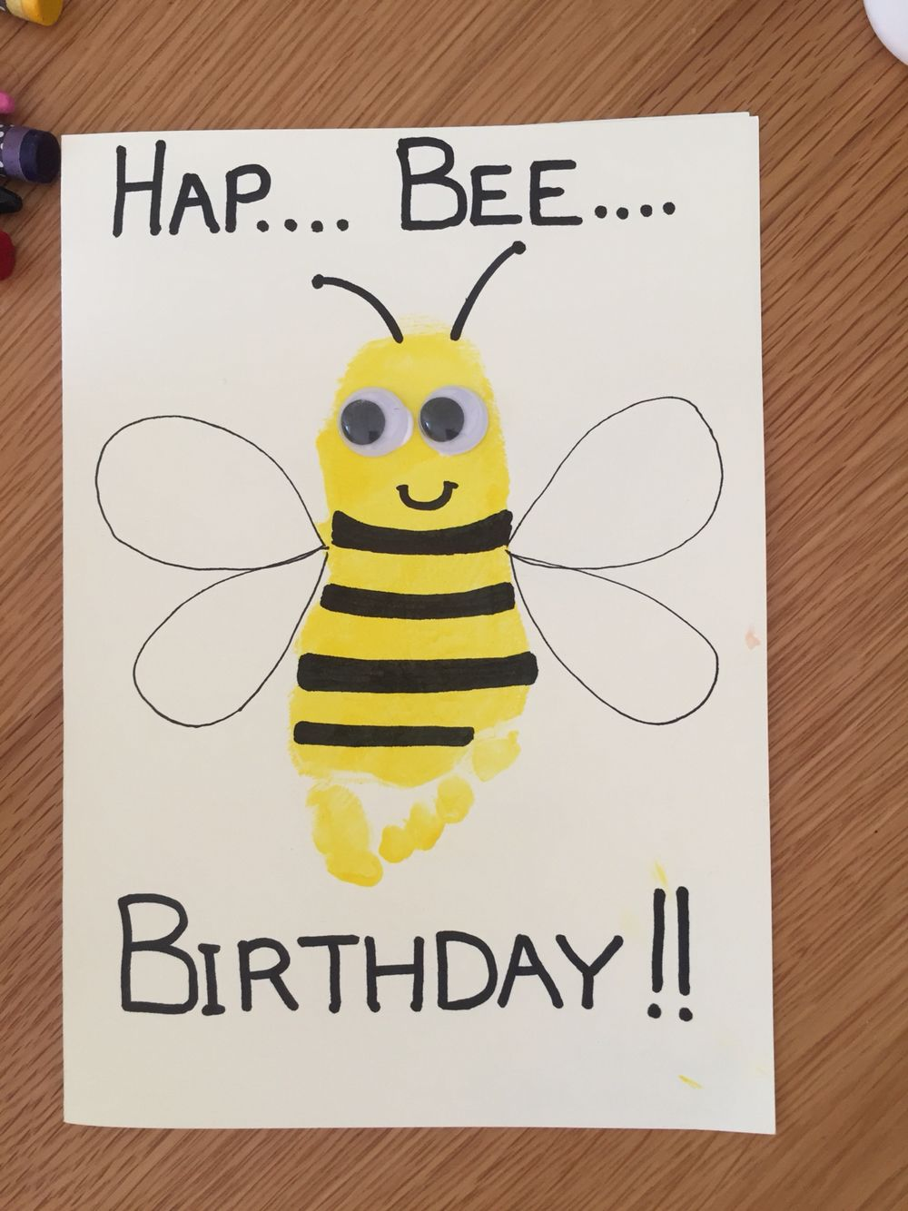 hap bee birthday card with toddler footprint and googley eyes
