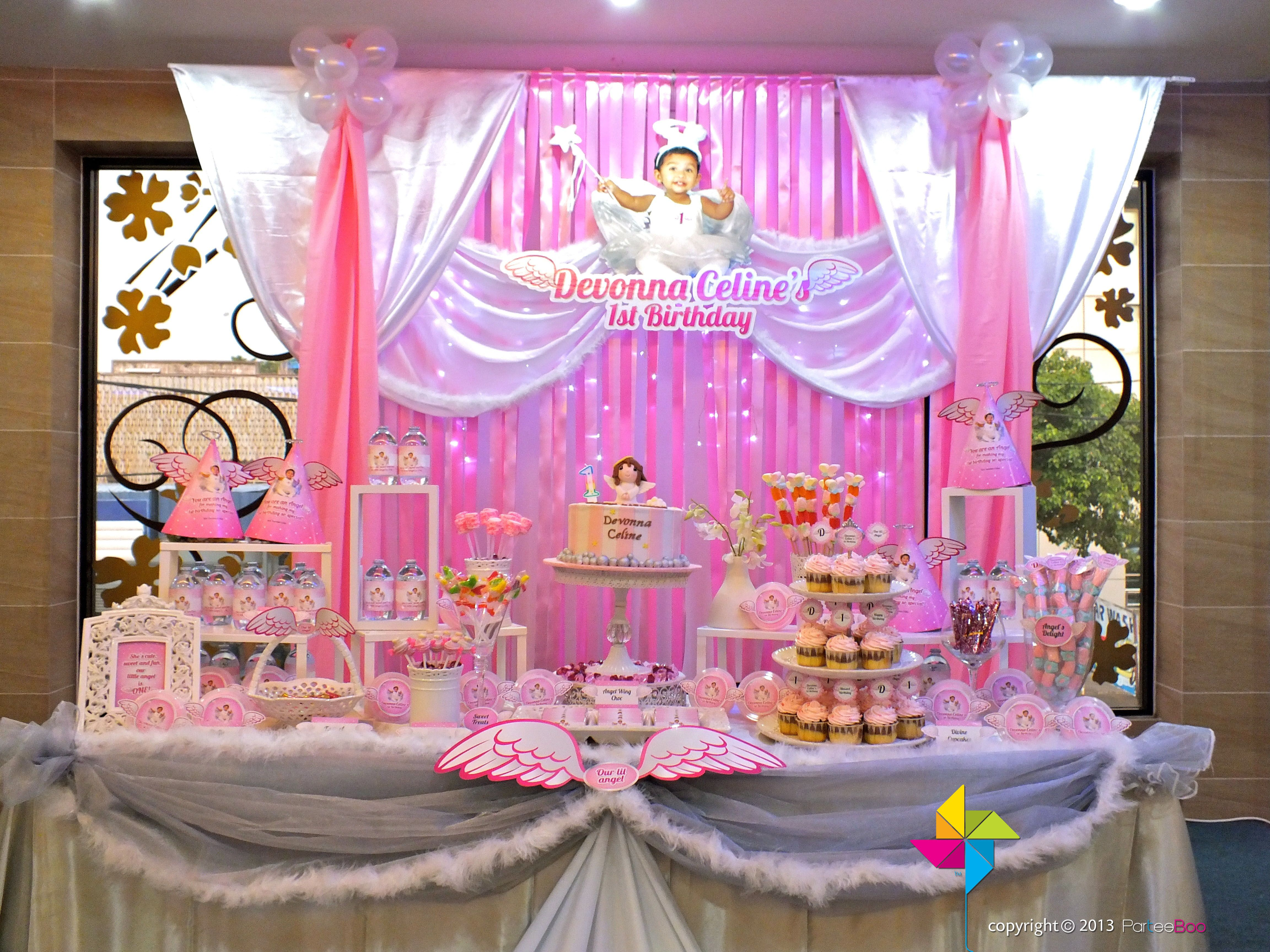 Backdrop cake candy table for a Heavenly Little Angel theme