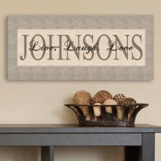 """Personalized gift idea for extended family members. A wrapped canvas surname sign with the phrase, """"Live, Laugh, Love."""""""