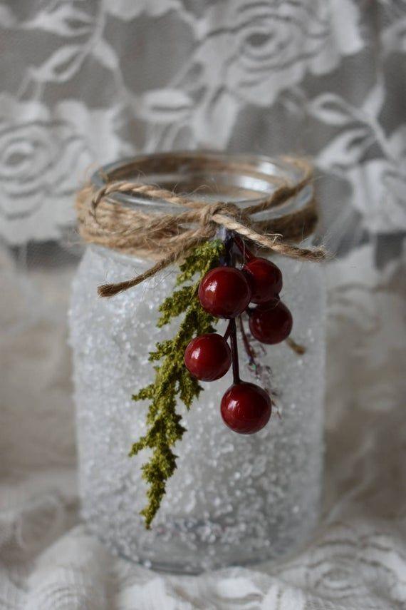 Photo of This is a handmade winter mistletoe mason jar with realistic snow …