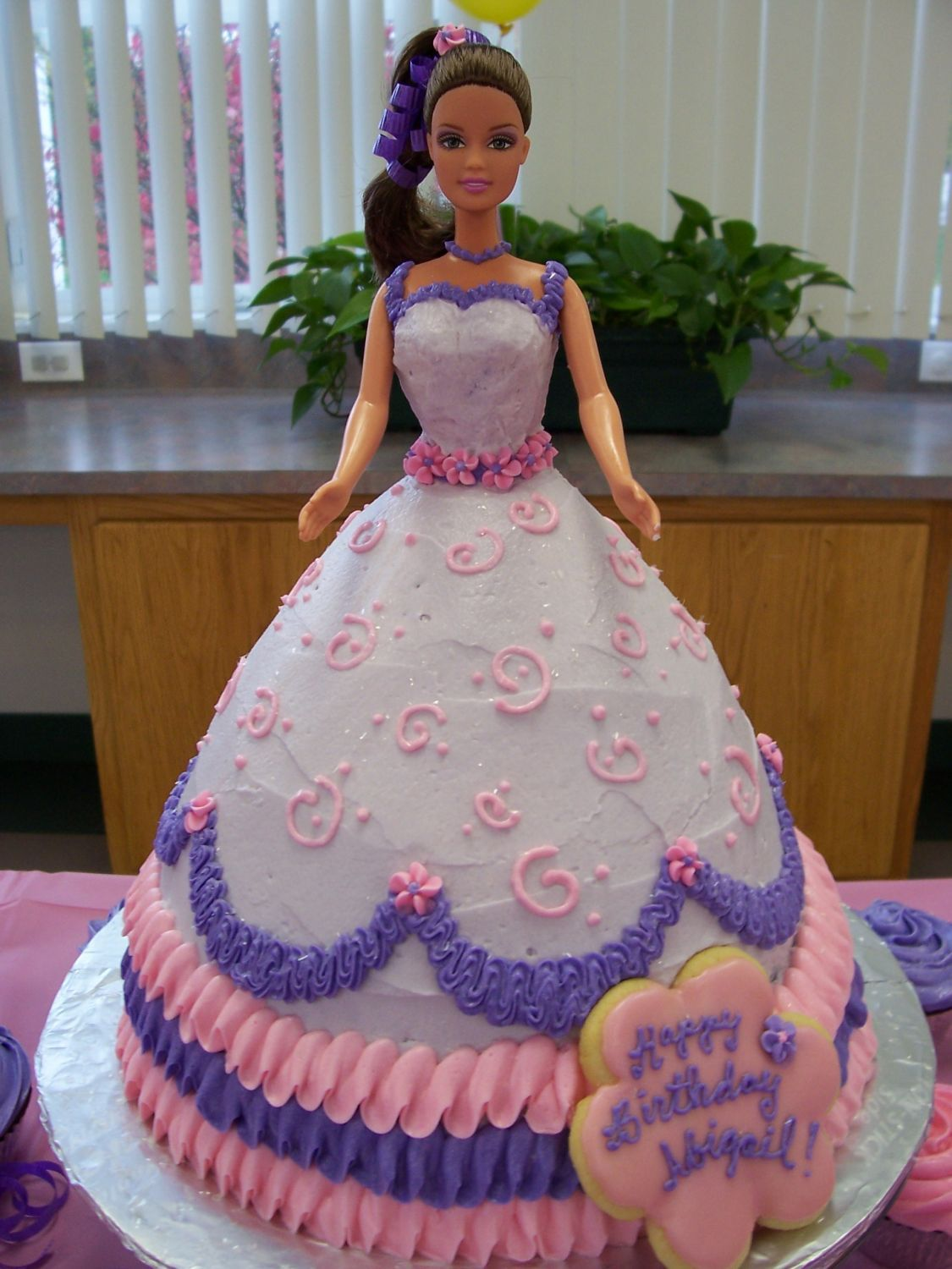 Barbie cake wonder mold cake stacked on 8 in round its