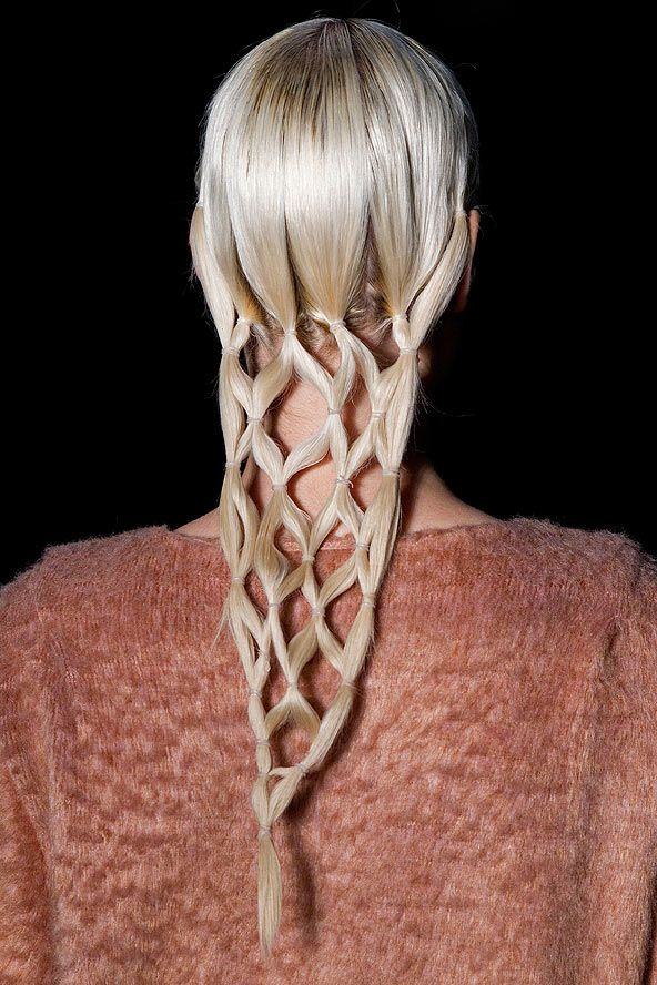 Get creative with ponytails and try multiple strands grouped together to simulate complex braids. We spotted this style on the Maria Bonita catwalk in Sao Paulo and had to share it: now get creative! // via Glamour Magazine UK