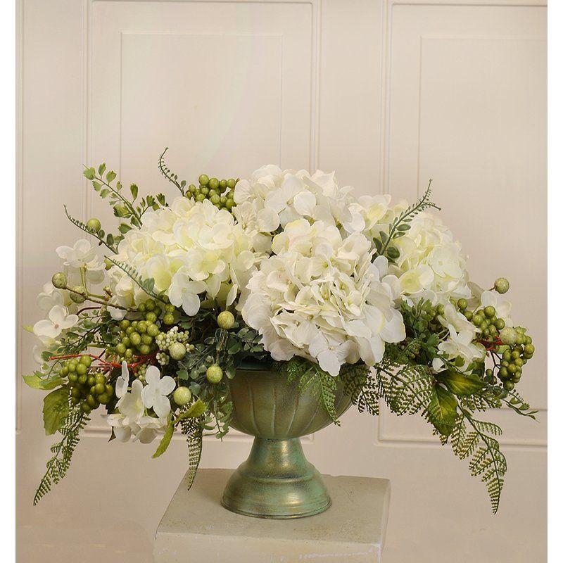Elegantly Styled Silk Flower Centerpiece Arranged With White Hydrangeas Accented With Berries Foli Flower Arrangements Flower Centerpieces Floral Arrangements
