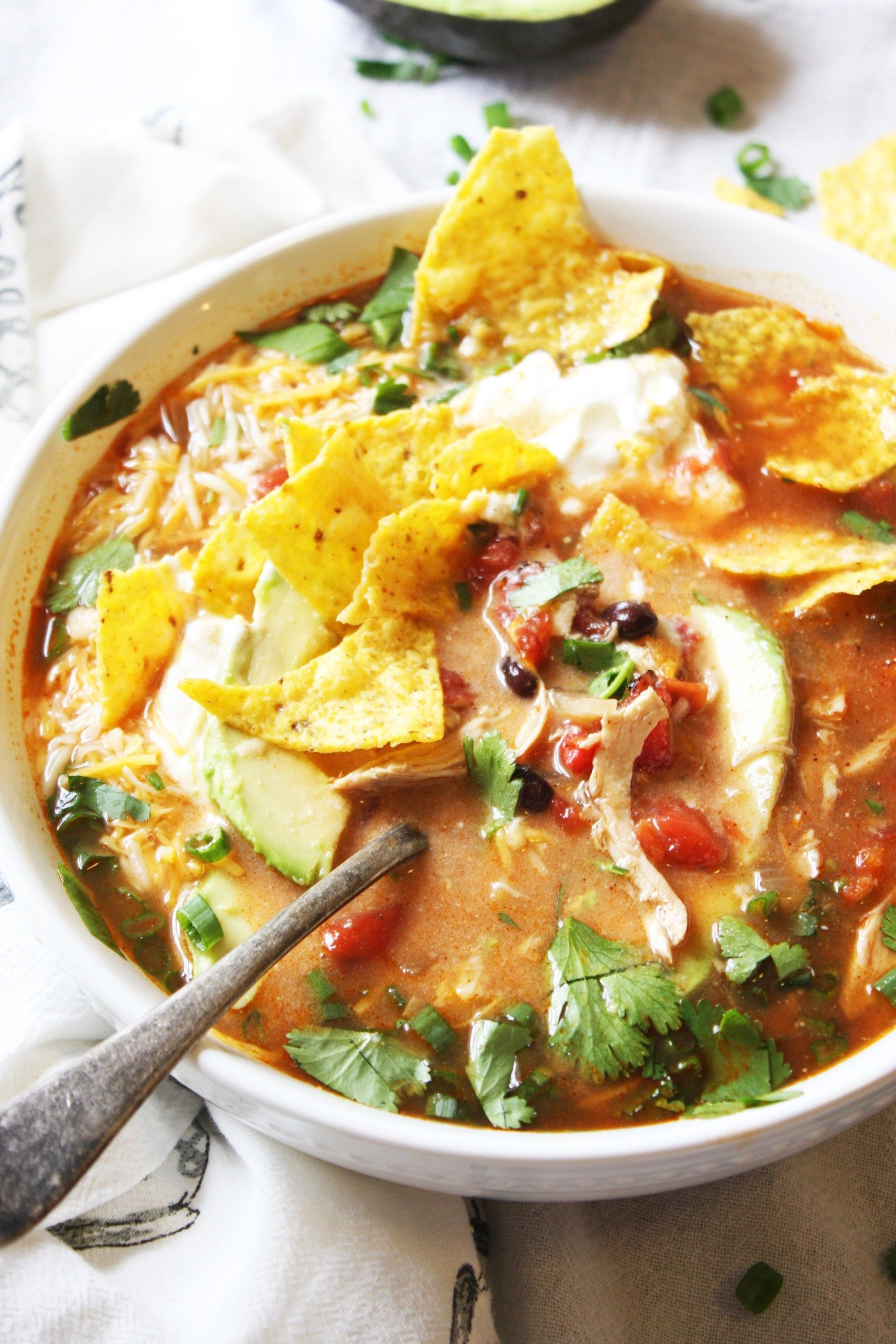 Chicken Tortilla Soup - This soup is so easy and SO yummy! It's all about those toppings, so pile 'em on! This will be a new family favorite in your home, and (bonus) it's gluten free :). TheGarlicDiaries.com #chickentortillasoup