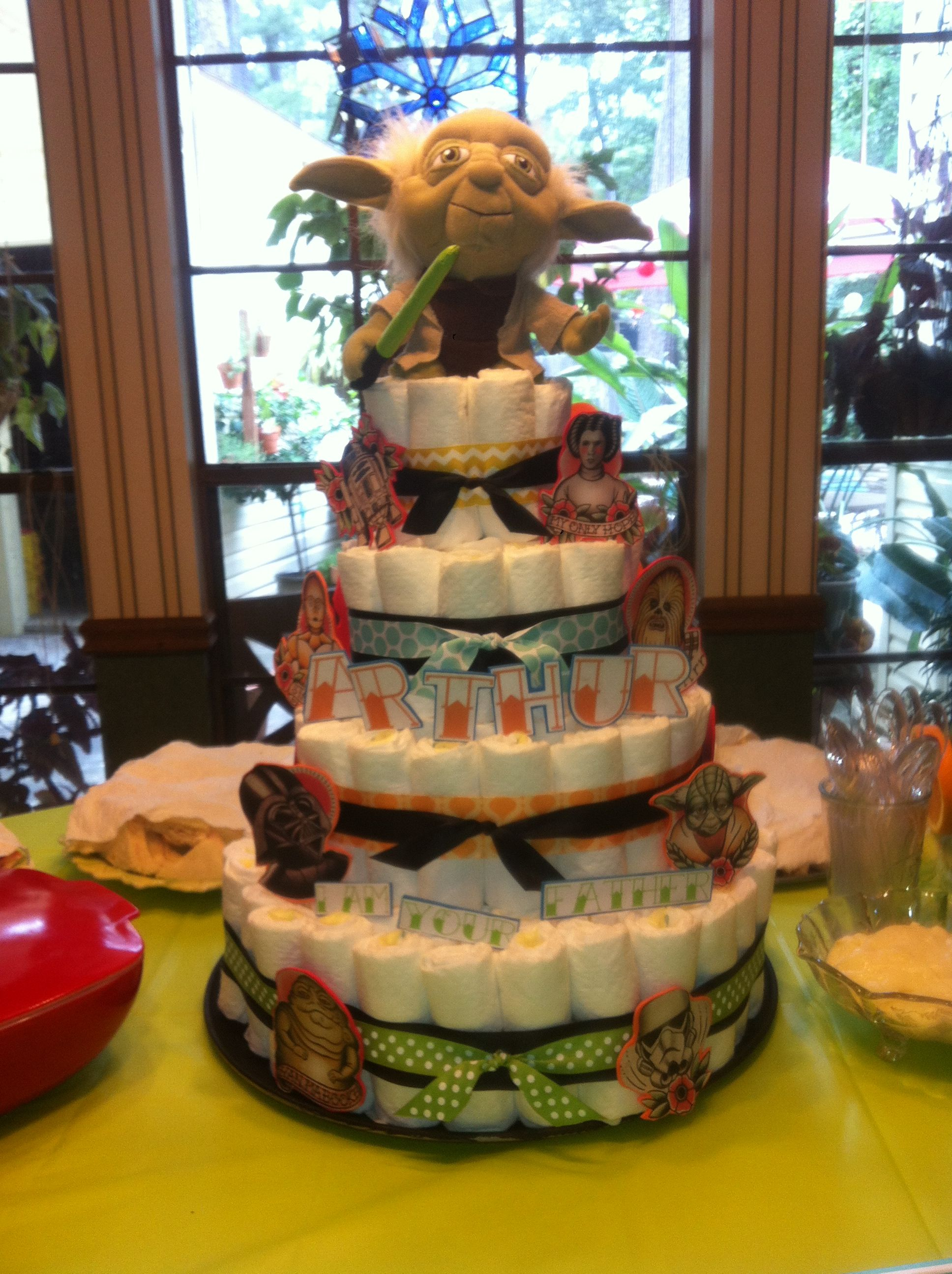 A diaper cake I made for a colorful Star Wars themed baby shower