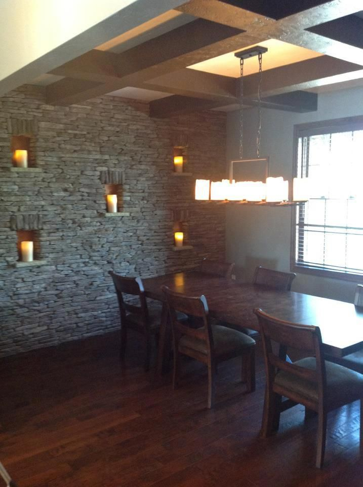 Cultured Stone Accent Wall With A Boxed Beam Ceiling In The Dining Room