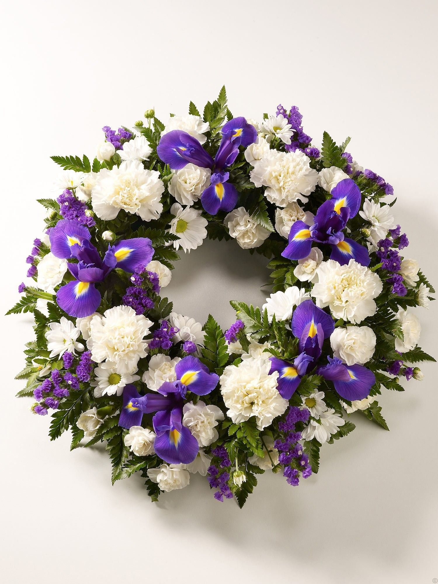 Image result for funeral arrangement flowers blue iris