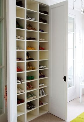 A Floor To Ceiling Shoe Shelf Hides Neatly Behind Double Doors The White Shelves Reflect Light Into Dark Cubbies Making Every Pair Easy See