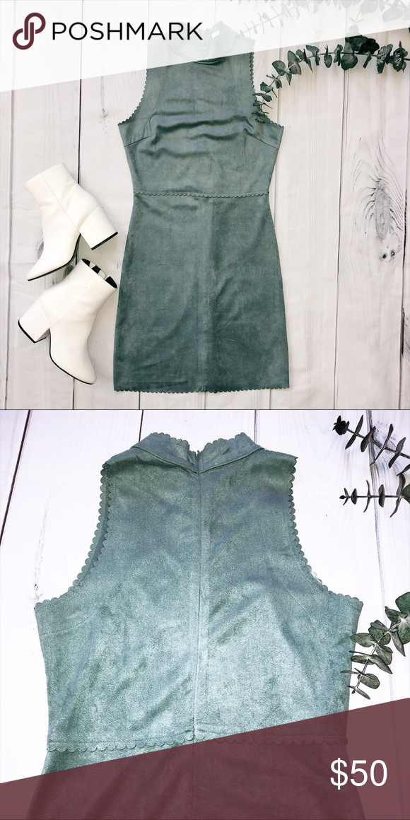 Suede Soprano Dress in Sage Green This beautiful sage green dress with scallop detailing is perfect for an elegant dinner or a night out. Its material is super soft and was only worn once!   Size: small Length: 34 inches Waist laid flat: 13 inches Zipper in back Condition: excellent Soprano Dresses Mini #sagegreendress